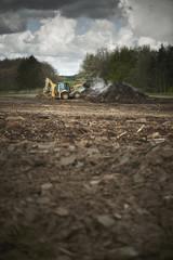 Fototapete - backhoe loader digging in the dirt