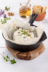 Baked camembert cheese with thyme and pepper