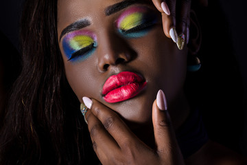 Beautiful black skin woman with fantasy bright makeup