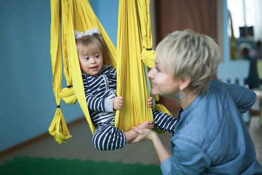 Doing yoga is mom and child Toddler Down syndrome