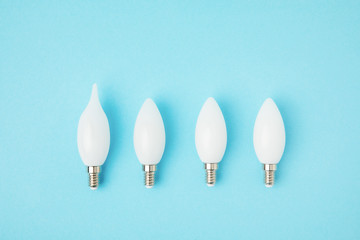 top view of different white lamps isolated on blue