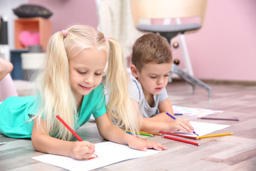 Cute little children drawing at home