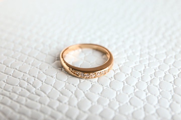 Beautiful engagement ring on textured background