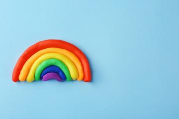 Plasticine rainbow on color background