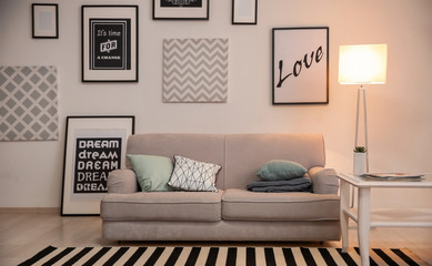 Interior of living room with comfortable sofa