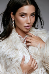 Winter Fashion Style. Beautiful Woman In Fur And Jewelry.