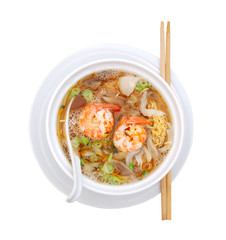 Asian noodle soup with fungus and shrimp in front of white background