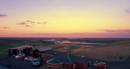 Fotobehang - Aerial view hotel overlooking beautiful landscape in South Iceland at sunset.