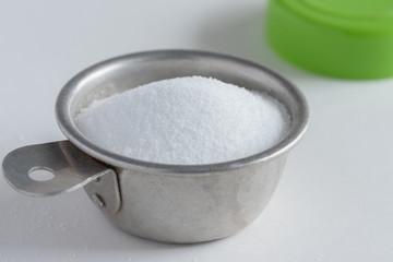 Citric Acid in vintage measuring spoon