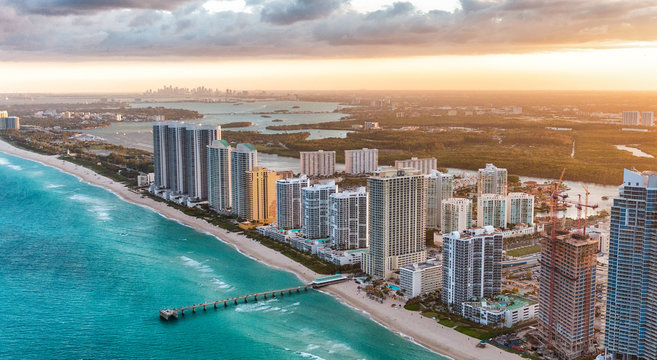 Miami Beach buildings at dusk, aerial view from helicopter