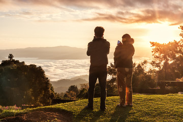 Huai Nam Dang National Park, Thailand - December/05/2017: Couple watching sunrise and misty in morning , Chiang Mai, Thailand.