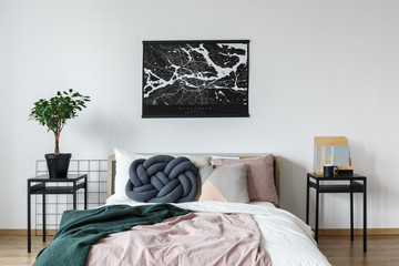 Minimalist poster above king-size bed