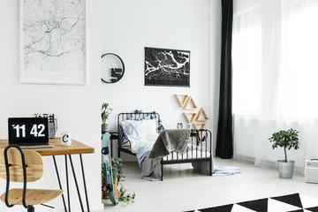 Wooden desk in simple bedroom