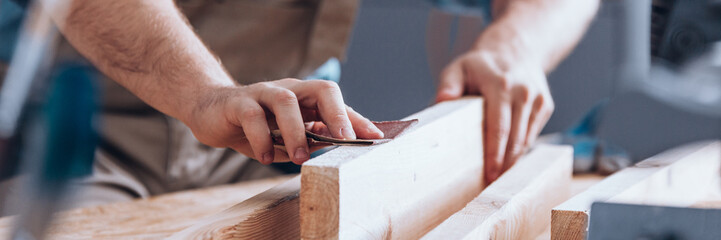 Sandpaper being used by woodworker