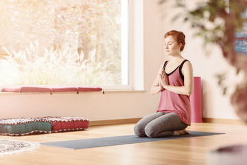 Relaxed woman in yoga center