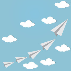 Paper planes fly in the sky with could.