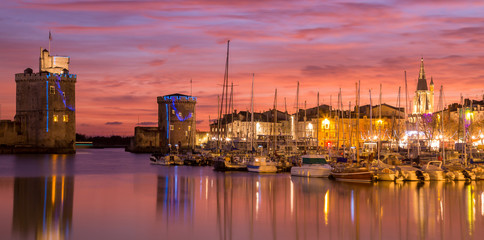 Fototapeten Koralle La Rochelle - Harbor by night with beautiful sunset