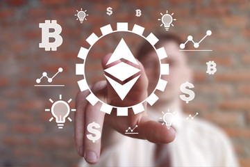 Businessman presses button Ethereum cryptocurrency on virtual digital electronic user interface currencies.