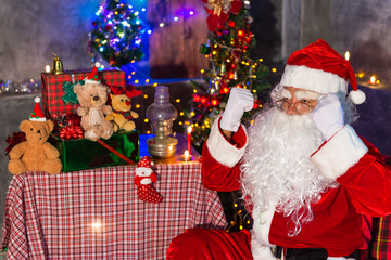 Stress Santa claus at home,Sit on chair think about plan for sent gift box for give children