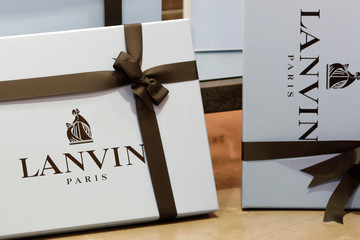 The logo of Lanvin, luxury clothing and accessories, is seen on boxes in a store of French fashion house Lanvin in Paris