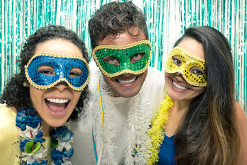 Group of Brazilian friends wearing Carnaval costume. Revelers are posing for the picture..