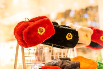 Multicolored Russian winter fur hats with stars