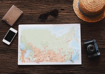 top view of objects on wooden texture for travel concept.