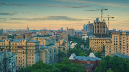 Fototapete - Morning sun light illuminating city skyline at sunrise. Moscow Russia. Timelapse