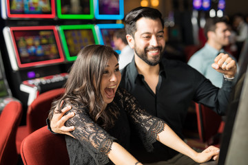 Excited couple hitting the jackpot