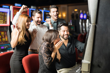 Excited woman winning in a casino