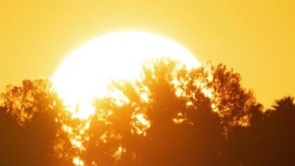 Fotobehang - Sunrise sun timelapse