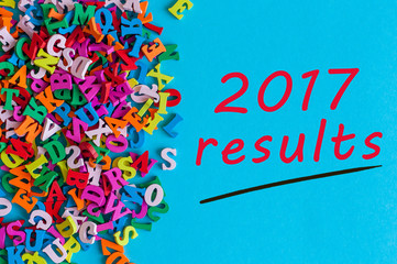 2017 results. Review of the Year. Note at blue surface near many little wooden letters