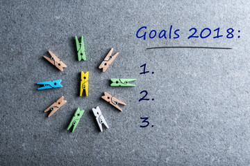 Top view 2018 goals chechlist at dark background with little pins