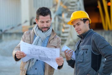 construction specialist and worker outdoors