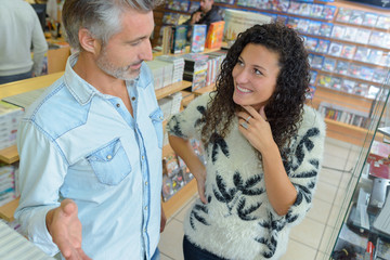 Man and young lady in electronics store