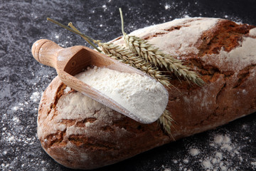 Freshly baked bread and flour in a bakery concept set