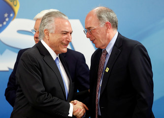 Brazil's President Michel Temer shakes hands with Brazil's state-run oil company Petroleo Brasileiro SA Chief Executive Officer Pedro Parente during the Petrobras 2018-2022 Business and Management Plan disclosure ceremony at the Planalto Palace in Brasilia