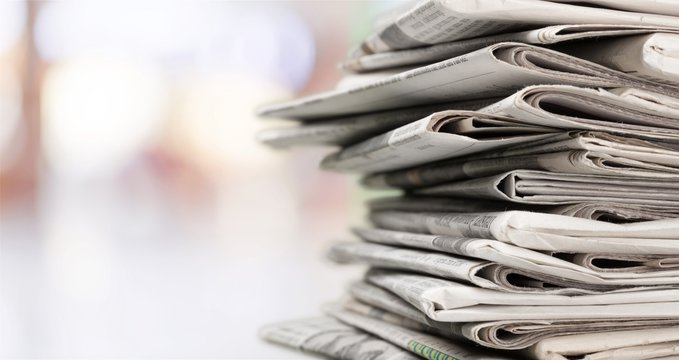 Stack of newspapers on background