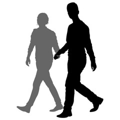 Silhouette man and woman walking hand in hand