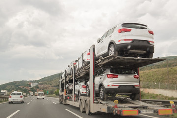 A Truck Making Transportation and Carries Cars For Selling on the Road