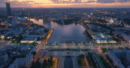 Fotobehang - Aerial view of city center with river bank at sunset. Yekaterinburg, Russia.