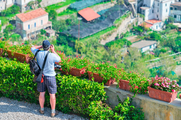 Man taking photos with camera in terrace in Ravello village