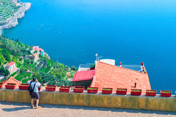 Man taking photos with camera in terrace of Ravello village