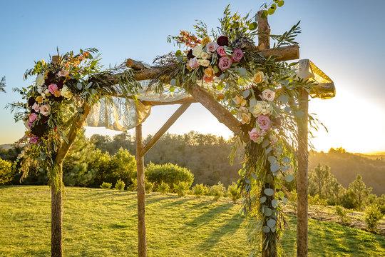 Jewish traditions wedding ceremony. Wedding canopy chuppah or huppah with golden light