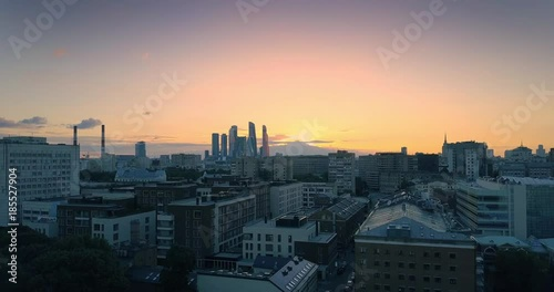 Fotobehang Ascending over rooftops, revealing aerial panorama Moscow city skyline at sunset