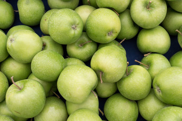 Fresh and Juicy Green Apples on Market Stall Ready For Sale