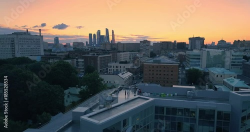 Fotobehang Aerial view of Moscow city skyline at sunset. Flying forward. 4K UHD.