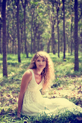 Abstract art portrait of elegant woman in summer sunny forest