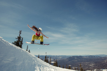 snowboard girl have fun and jumping in snow. Winter sport holiday mountains sky resort