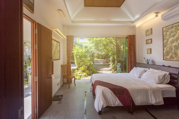 Luxury villa bed room interior. Open space, garden terrace